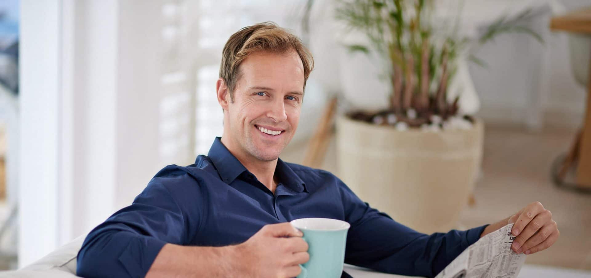 Happy-man-drink-coffee-after-hair transplant-by-hasci